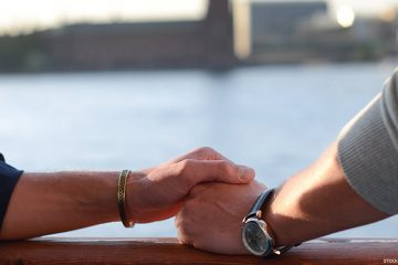 Gay couple holding hands in Stockholm, Sweden